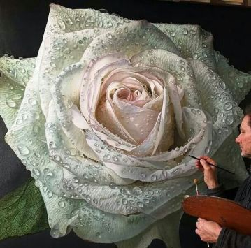 Extremely realistic painting of a white rose with pinkish interior with the artist standing in the right corner