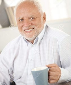 Old man with a forced happy expression holding a mug