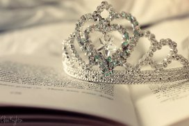 Tiny tiara on top of an open book