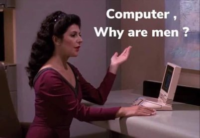 """Picture of Counselor Troi from Star Trek: The Next Generation sitting at a computer desk with her hand raising. The caption says """"Computer Why are men?"""""""